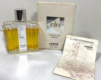Vintage Caron INFINI perfume de toilette with box 2 FL OZ bottle, some used