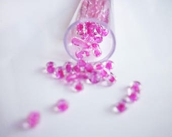 1 tube of mini pink seed beads clear 2mm