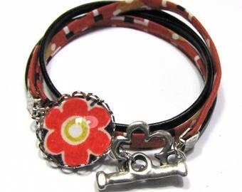 Pop flower cabochon bracelet, black leather and fabric, orange
