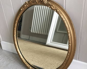 "SOLD Vintage decorative gold gilt oval mirror 21.5"" by 16"""