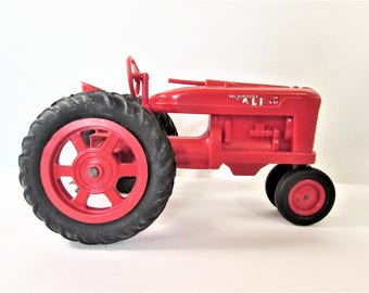 Red Farmall Tractor Plastic Product Miniatures Vintage Farm Toy