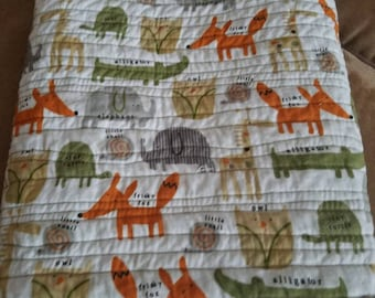 Cuddle your little one in this soft quilt