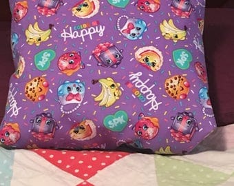 Shopkins throw pillow back is solid color