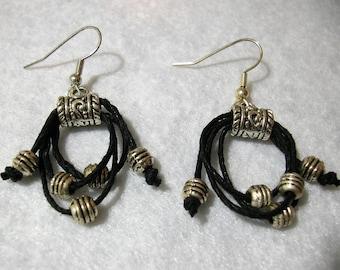 Black hoop earrings with silver beads