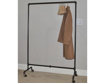 Urban Industrial iron plumbing pipe rolling garment rack.  Clothing rack for convenient clothes storage.  Store fixture