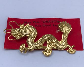 Vintage lucky dragon pin on original card.