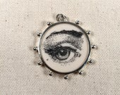 Reproduction Scrimshaw Eye Pendant in Sterling Silver Frame