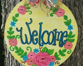 Yellow circular floral welcome door hanger or family sign