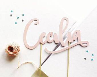 Cake Topper shaped in pearly or opaque cardboard personalized with name or phrase