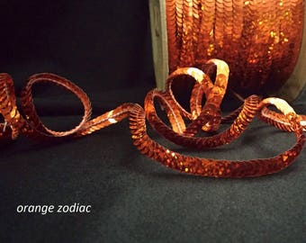 orange zodiac (hologram) sequin trim--stretch