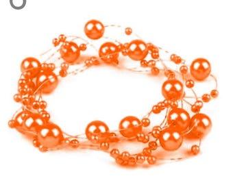 Wreath adorned with pearls orange 130 cm