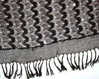 Large 1930s fringed black knit shawl or tablecloth. Great for costume use. Drapes beautifully.