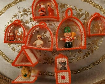 Plastic canvas ornaments with vintange Christmas decorations.