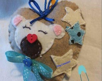 Bow Blue cockade Heart of felt with teddy bear decoration.