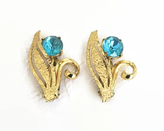 2 shoe or dress clips, gold metal flowers with leaves and stems and 2 large turquoise glass stones, circa 1960s