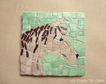 Under glass/mug in a Bay horse mosaic under
