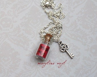 """Red """"Drink Me"""" vial necklace"""