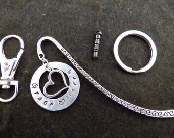 Hand stamped aluminium washer with message and heart charm on the accessory of your choice.
