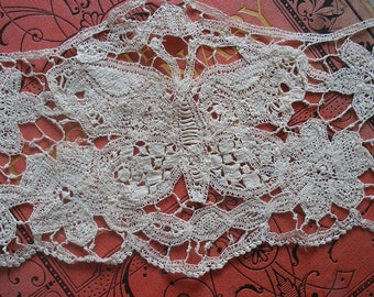 Antique handmade lace dress trim with butterflies