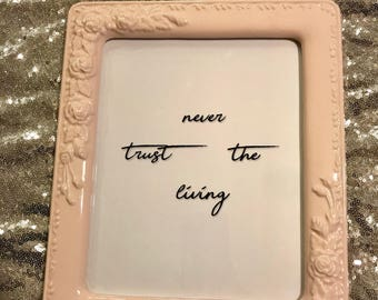 Never Trust The Living sign