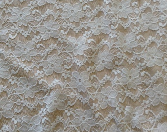 "Stretch Lace Fabric in a white color with a floral weave, 4-way stretch, 62"" wide"