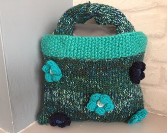 Hand knitted top handle bag.