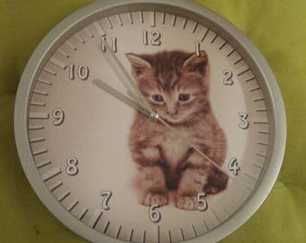 clock wall pattern kitten
