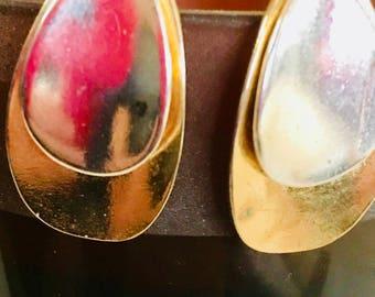 Teardrop gold and silver tone stud earrings