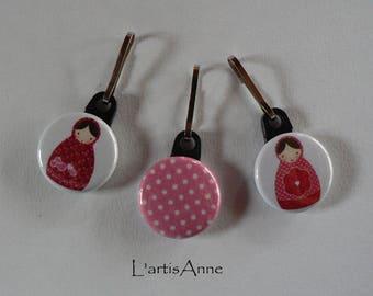Zip Strap Badge set of 3 nesting dolls and polka dot zipper pull.