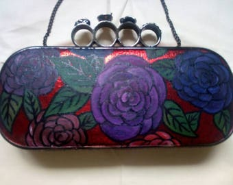 Hand painted knuckleduster clutch bag