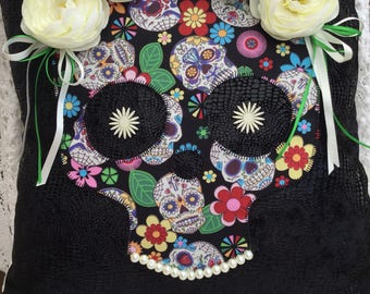 Handmade appliquéd skull cushion