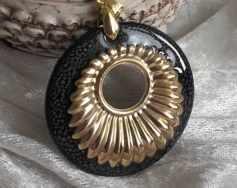 black gold is handmade, round pendant with wood and resin