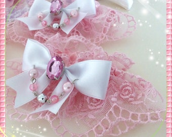 Beautiful pink Sweet Lolita wristcuffs made of fine tulle lace ,decorated with a satinbow rhinestones and pearls