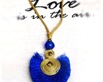 Flat, sapphire blue gold cord tassel necklace