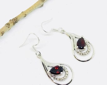 10% Garnet earrings set in sterling silver (92.5). Genuine natural garnet stones. Perfectly matched.