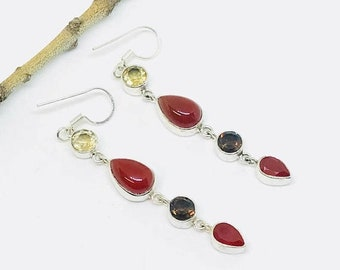 10% Carnelian , citrine, smokey topaz earrings set in sterling sliver 92.5. Natural authentic stones. Perfectly matched. Length- 2 inch.