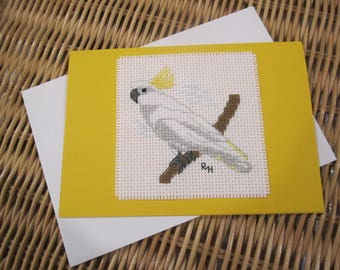 Hand cross stitched Australian native bird card - Sulphur-Crested Cockatoo.  Yellow card with white envelope and white paper insert.