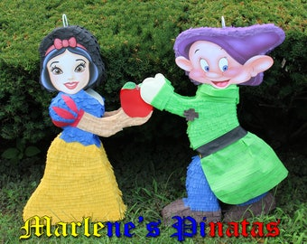 Snow White or her dwarf Dopey pinata.. !