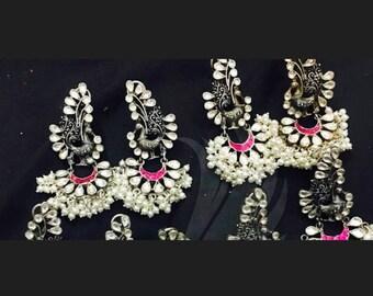 Pure silver mayuri earrings