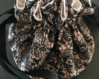 Jewelry purse divided cotton Black Lace on pale pink background