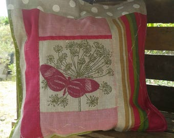 Pink linen cushion with butterfly cover