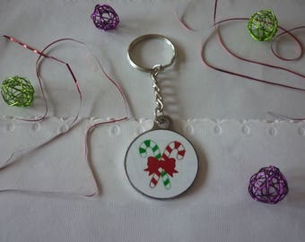Two red and green Christmas and a red bow, medium silver barley sugar and cabochon keychain.
