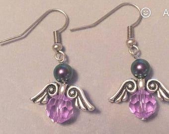 Hand made adorable angel dangling earrings.