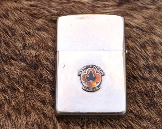Vintage Zippo lighter form the 43rd Infrantry Division this lighter is dated 1964