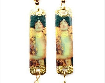 Earrings with pendants depicting a woman in the manner of Klimt