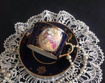 Fragonard lovers cabinet cup and saucer.  Limoges.  Signed.  Deep cobalt blue