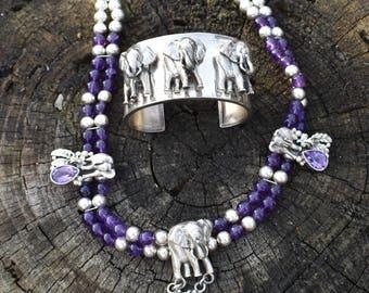 Carol Felley sterling and amethyst elephant huge squash blossom necklace.