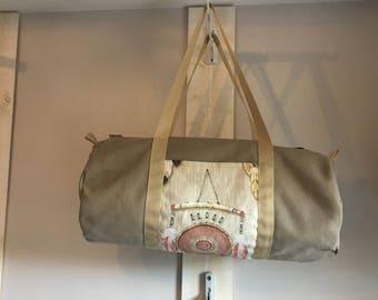 Beige canvas duffel bag