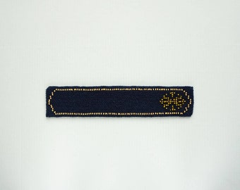Knitted sun symbol bookmark - navy wool with gold and sand glass beads, handmade bookmark, fabric bookmark - ready to ship