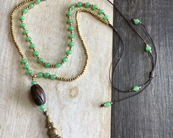 Long green beaded necklace, double green necklace, double beaded necklace, green necklace with brass charm, long boho green necklace